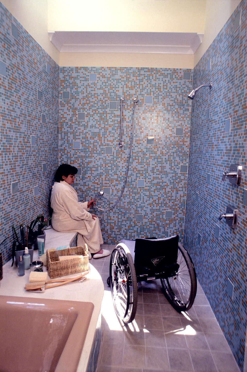 senior woman sitting on specifically designed wet area shower bench