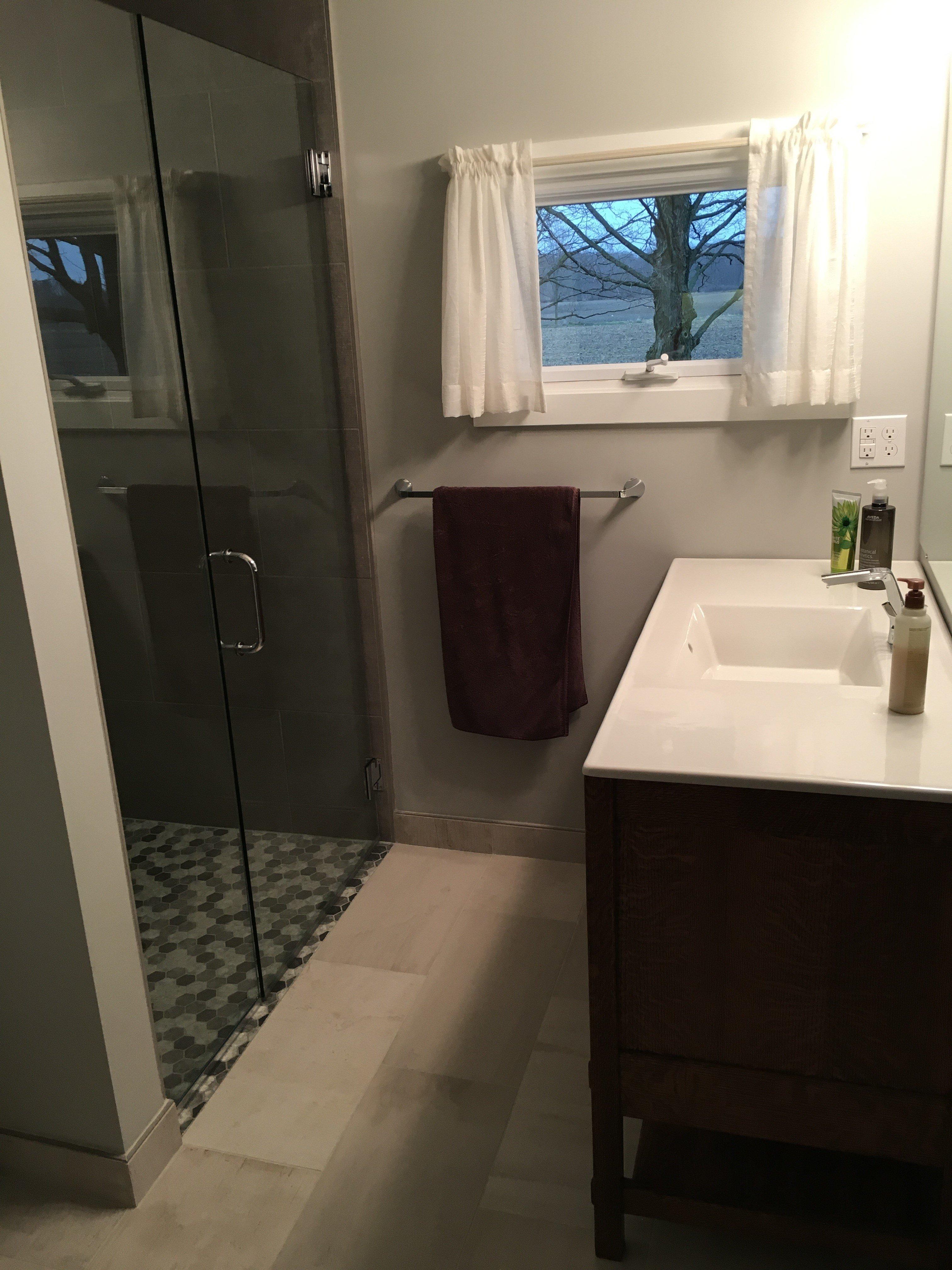 Heated curbless shower in bathroom