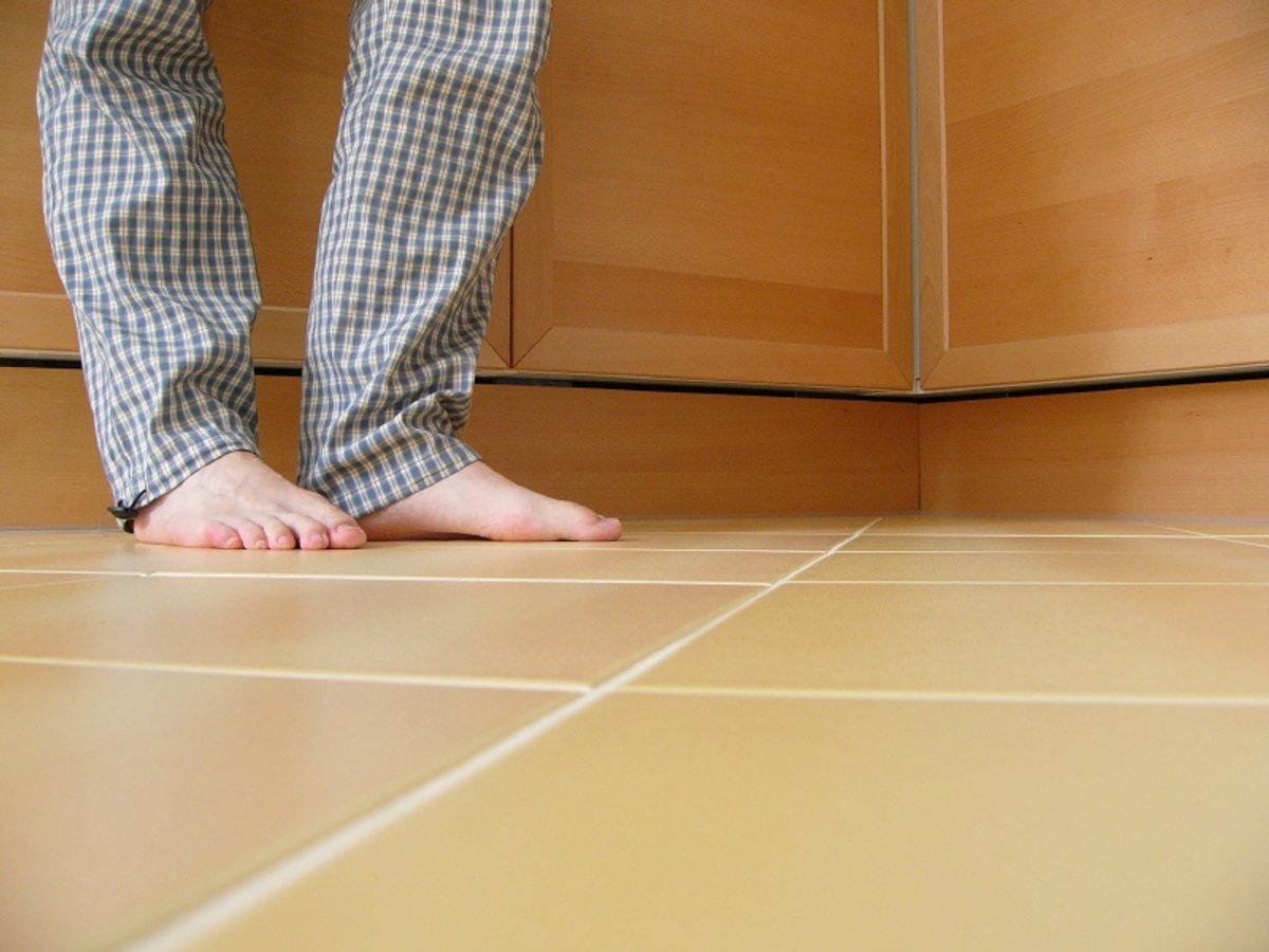 Feet Kitchen Tiles Stock Photo