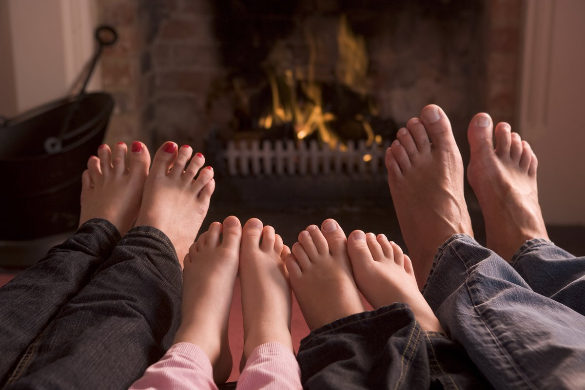 Feet warming in front of the fireplace