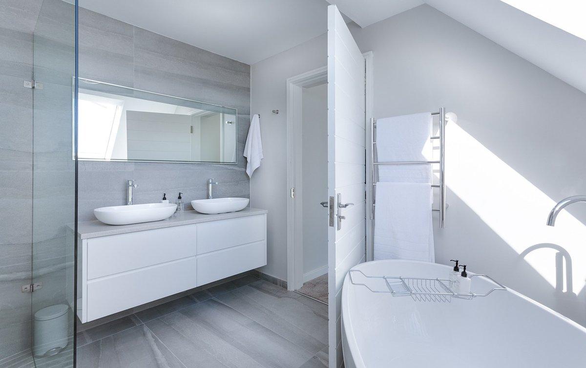 Modern minimalist hotel bathroom with towel warmers