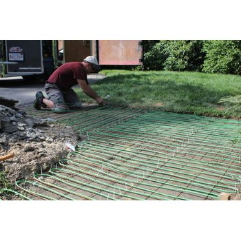 Snow melting cable install for heated walkway e44b1e