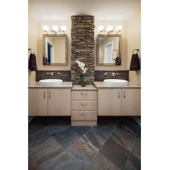 Two sink bathroom with stone pillar f3a269