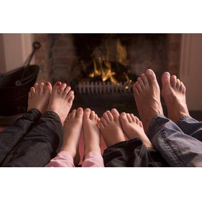 Bare Feet Fireplace Family Lifestyle Stock Photo