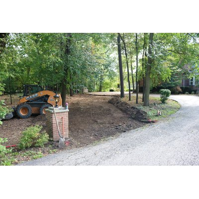 Home with driveway expansion in progress