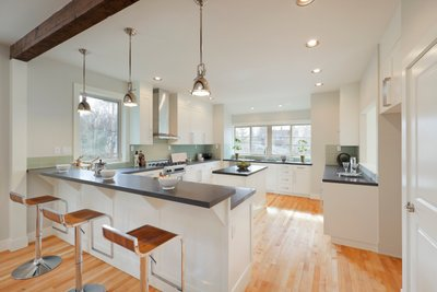 Kitchen with Bar and Hardwood Floors