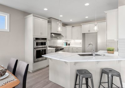 Modern Kitchen with Marble countertops and wood floor