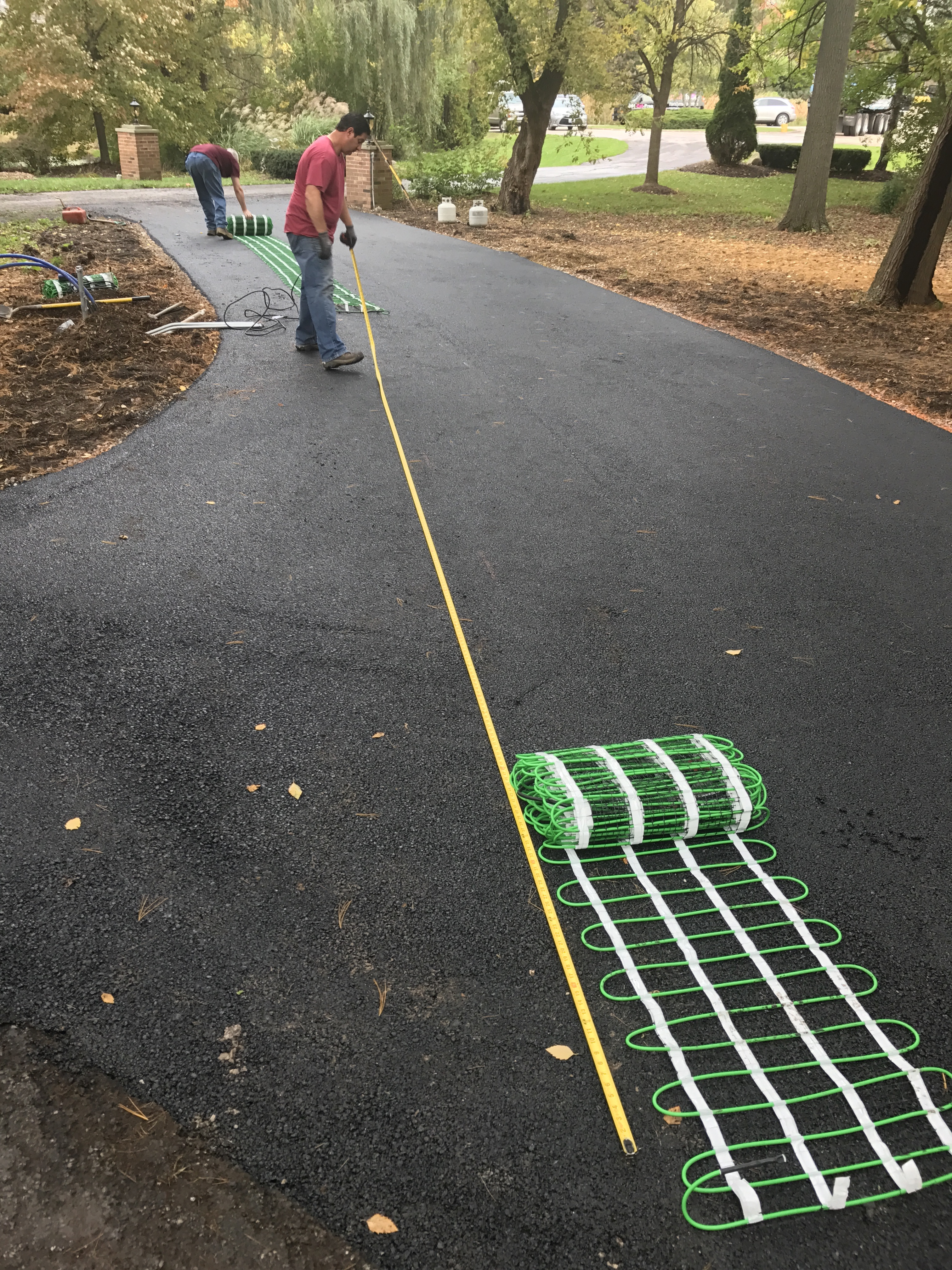 dryfitting snow melt mats on asphalt driveway