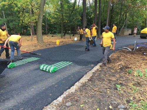 Installing snow melt mats on asphalt driveway