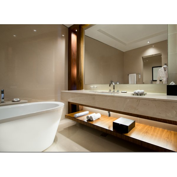Bathroom with freestanding tub, a floating vanity and open storage