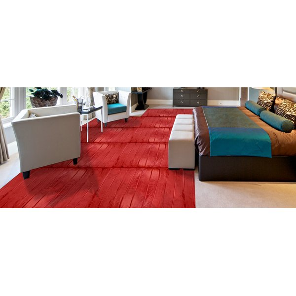 Demonstration of heat output of electric floor heating rolls installed in carpeted bedroom