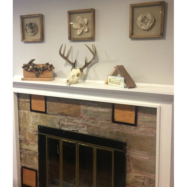 Mantle over a fireplace with rustic decoration