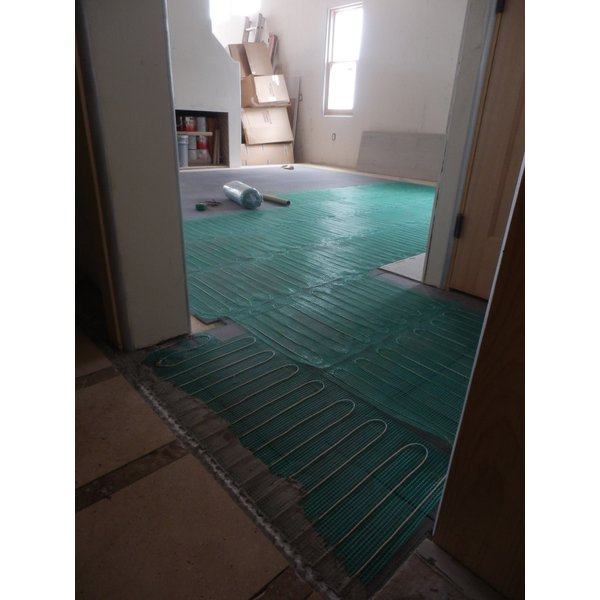 Solar powered radiant floor heating.
