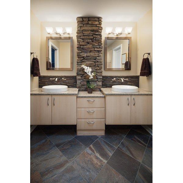 Two sink bathroom with stone pillar