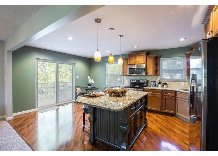 Indoors Kitchen Island with Laminate wood Flooring